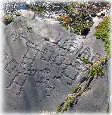 Rock art: warriors in duel and inscriptions at Seradina, Capo di Ponte, Valcamonica